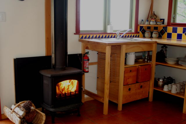 Hairy Hobbit Eco Lodge - kitchen and fire place