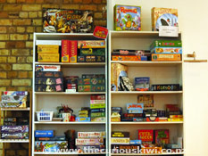 Shelves of games at Cakes n Ladders