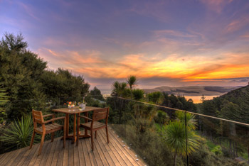 Kokohuia Lodge - Deck at sunset